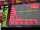 file-photo-a-man-monitors-an-electronic-board-displaying-stock-prices-at-the-karachi-stock-exchange-2-2-2-3-2-2-2-2-2-2-2-3-2-2