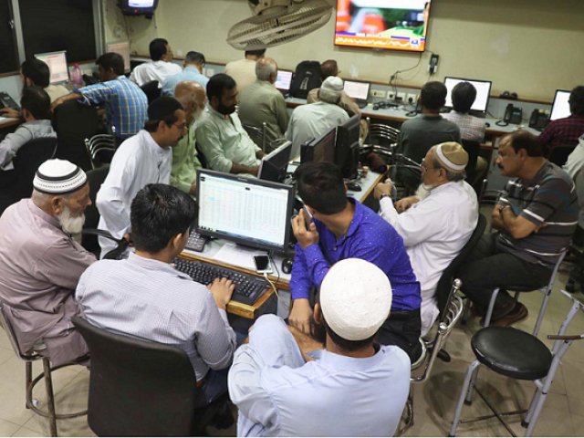 Stock brokers watch television as  stock market experiences rapid changes. PHOTO: ONLINE/FILE