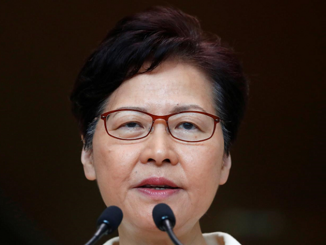 Hong Kong leader vows to 'listen humbly' after shock poll result