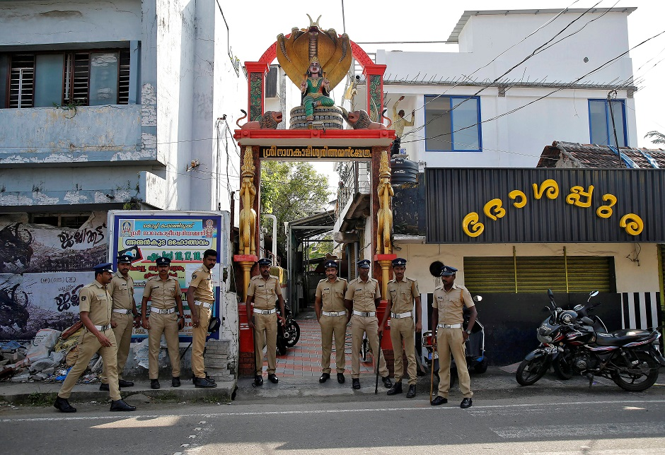 Policemen stand guard outside a temple before the Supreme Court's verdict on a disputed religious site claimed by both majority Hindus and Muslim in Ayodhya. PHOTO: Reuters