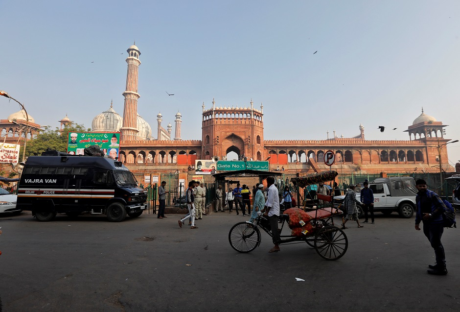Policemen stand guard at a gate of Jama Masjid, before Supreme Court's verdict. PHOTO: Reuters