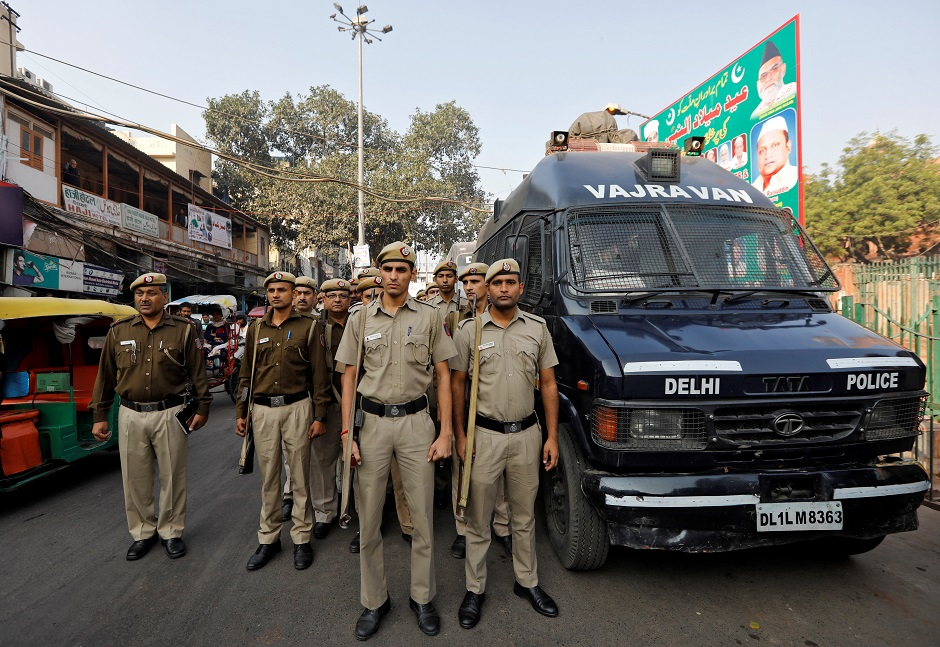 Police officers conduct a flag march in a street outside Jama Masjid, before Supreme Court's verdict. PHOTO: Reuters