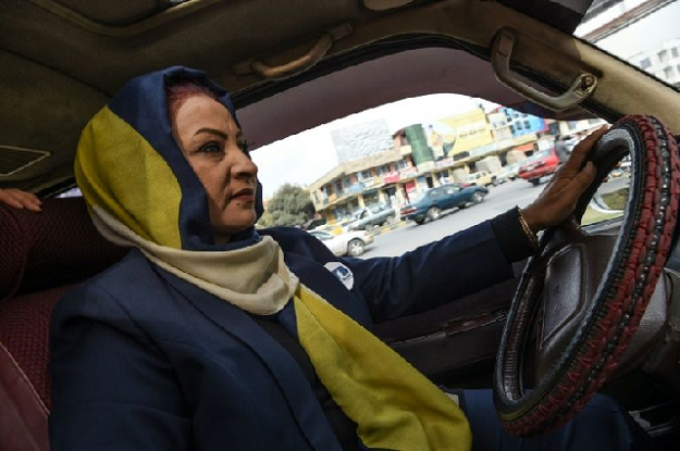 Parisa Haidary drives a mini-bus to pick up women passengers in Kabul. PHOTO: AFP