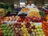a-vendor-sells-vegetables-and-fruits-at-the-city-market-in-st-petersburg-2-2-4-2-2-2