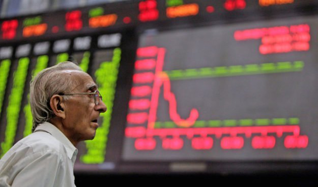 file-photo-a-man-monitors-an-electronic-board-displaying-stock-prices-at-the-karachi-stock-exchange-2-2-2-3-2-2-2-2-2-2-2-3-2-3-2-2-2-2-2