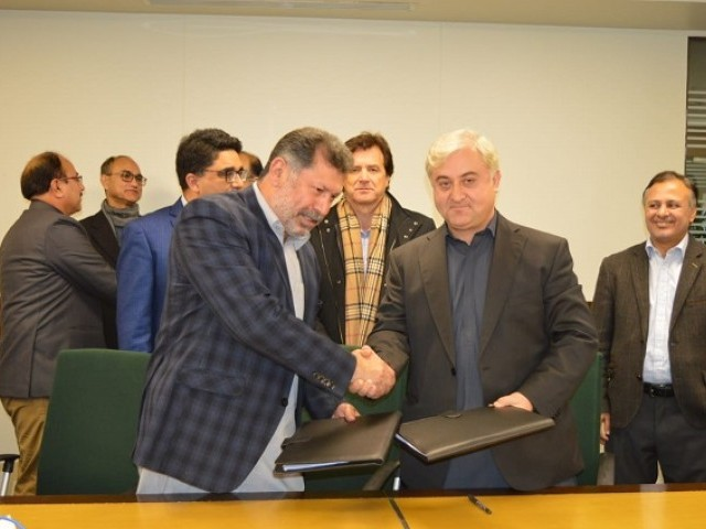Gilgit-Baltistan's Economic Transformation Initiative and Aga Khan Rural Support Programme ink the agreement in Islamabad. PHOTO: EXPRESS