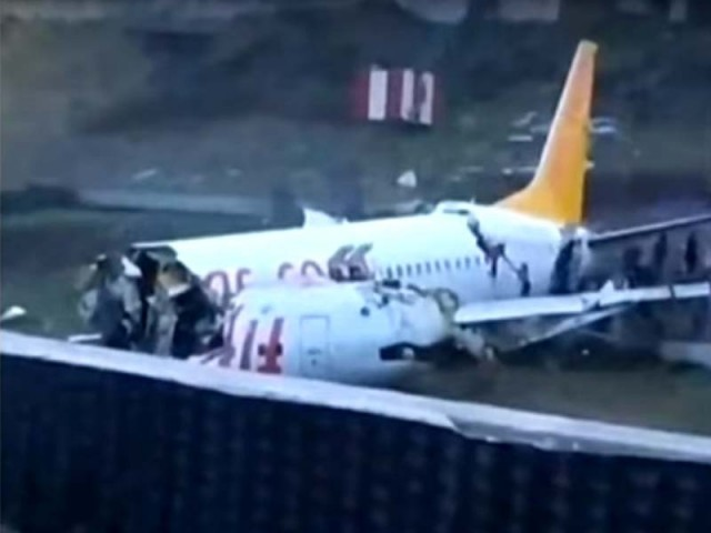 Plane splits in three after skidding off Istanbul runway""