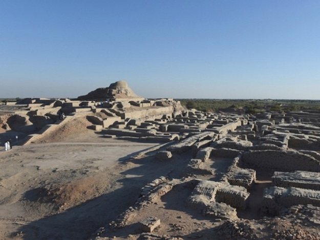 In this photograph taken on February 9, 2017, visitors walk through the UNESCO World Heritage archeological site of Mohenjo Daro some 425 kms north of the Pakistani city of Karachi. Once the centre of a powerful civilisation, Mohenjo Daro was one of the world's earliest cities -- a Bronze Age metropolis boasting flush toilets and a water and waste system to rival modern standards. Some 5,000 years on archaeologists believe the ruins could unlock the secrets of the Indus Valley people, who flourished around 3,000 BC in what is now India and Pakistan before mysteriously disappearing. PHOTO: AFP.