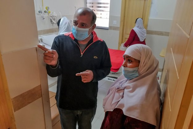 Medical staff members wearing protective masks prepare a room in an isolation ward as a preventative measure following the coronavirus outbreak, at the Pakistan Institute of Medical Sciences hospital in Islamabad. PHOTO: AFP/FIle