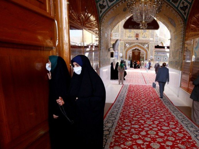 Iraqi female pilgrims wearing protective face mask at Imam Ali Shrine. PHOTO: REUTERS