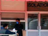 In a file photo men are seen wearing protective mask as a preventive measure against coronavirus, as they stand outside the Isolation ward at the Pakistan Institute of Medial Sciences (PIMS) in Islamabad. PHOTO: REUTERS