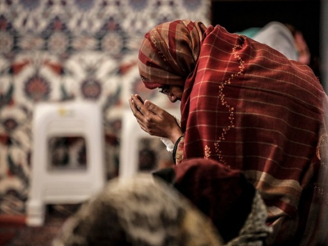 Representational image of a women praying in a mosque. PHOTO: AFP