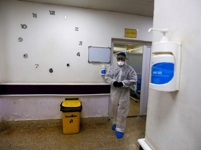 A member of the medical team walks near quarantine room of a hospital, following the outbreak of the new coronavirus, in the holy city of Najaf, Iraq February 24, 2020. PHOTO: PHOTO: REUTERS