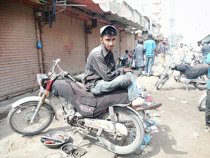 A motorcycle mechanic in Karachi. PHOTO: EXPRESS