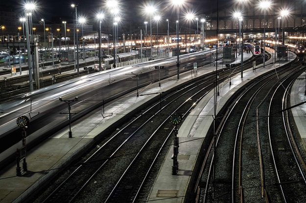 This photo taken in Paris shows tracks at the Gare du Nord rail station after all non-essential public places including restaurants and cafes have been shut as a precaution to contain the spread of the COVID-19. PHOTO: AFP