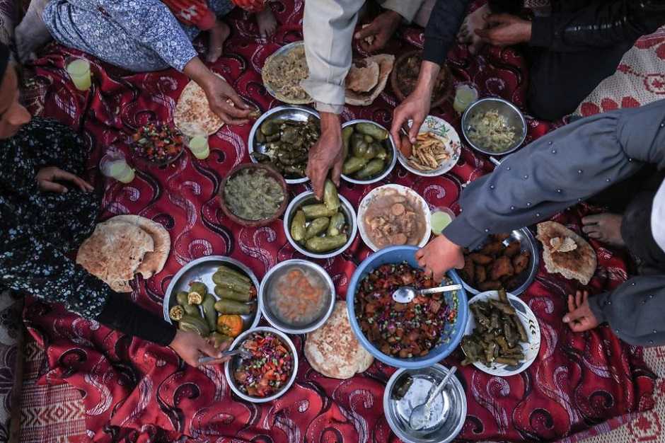 Palestinian family break their fast during iftar dinner of Ramadan in Gaza City, Gaza on April 26, 2020. PHOTO: ANADOLU AGENCY