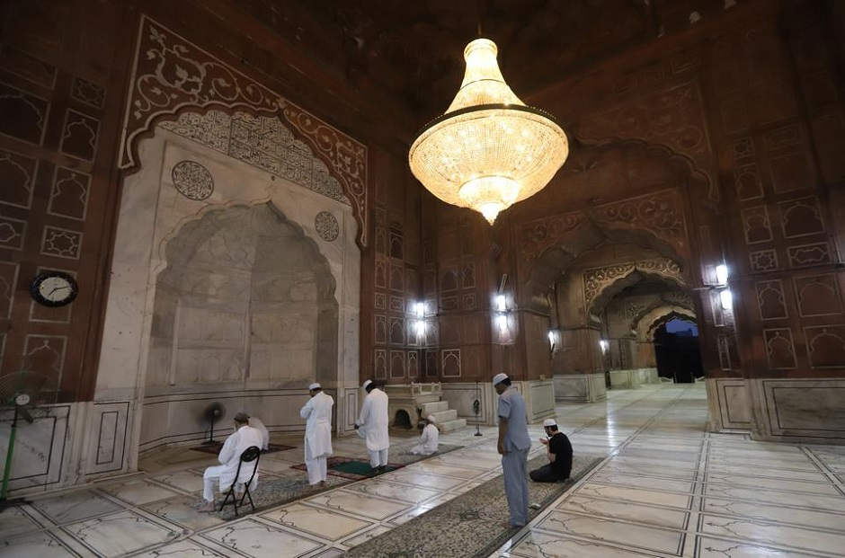 Caretakers of the Jama Masjid mosque perform evening prayer on the first day of Muslim holy fasting month of Ramadan during a nationwide lockdown to slow the spreading of the coronavirus disease (COVID-19) in Delhi, India on April 25, 2020. PHOTO: ANADOLU AGENCY