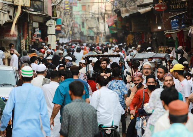 People are seen on a street ahead of Eidul Fitr after some restrictions were lifted during an extended nationwide lockdown to slow the spread of the coronavirus disease, in New Delhi, India. PHOTO: Reuters