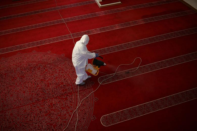 A man disinfects the Banya Bashi mosque, before the last Friday prayers of fasting holy month of Ramadan ahead of Eidul Fitr celebrations, in Sofia, Bulgaria. PHOTO: Reuters