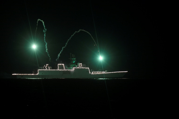 An Indian navy ship anchored off the coast of Chennai is illuminated in tribute to those fighting against the spread of COVID-19. PHOTO: AFP