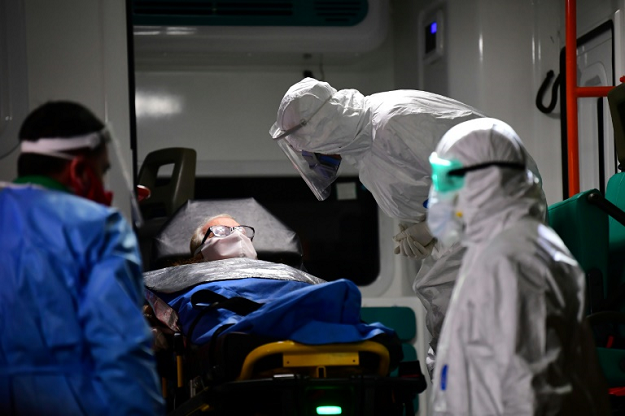 An elderly man with symptoms of the new coronavirus is carried into an ambulance to be transferred from the Carpe Diem nursing home to a hospital in Buenos Aires. PHOTO: AFP